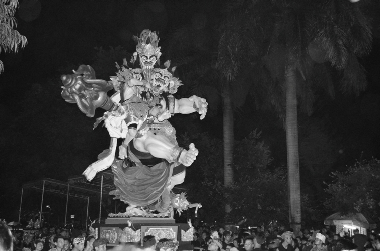 A giant puppet symbolizing demon (Bhuta Kala) is paraded around village at Nyepi Eve (one night before Balinese's Day of Silence). At the end of parade, Ogoh-ogoh will be burnt to represent a banishment of evil spirit.